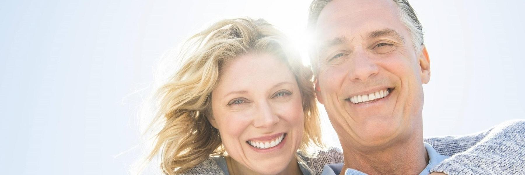 Couple Smiling Outdoors | Dentist in Fort Collins, CO