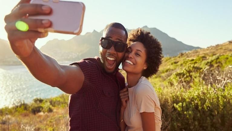 Couple taking a selfie on a hike | Dentist in Fort Collins