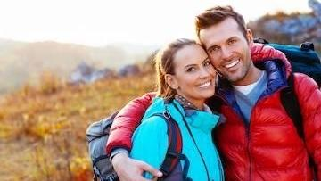 Couple Hiking with white teeth in fort collins co